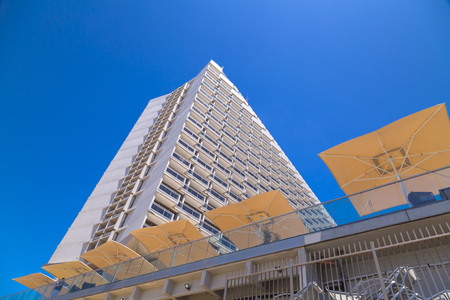Tel Aviv-Yafo, Israel - June 6, 2018: Facade view of the Hilton Tel Aviv Hotel at the Tel Aviv beach. The building reflects the mid-century modern, modernist style. Editorial
