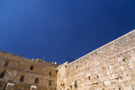 The Western Wall, the second holiest place to the Jews. The Wall is the last remnant of the second temple of Jews in Jerusalem. Stock Photo