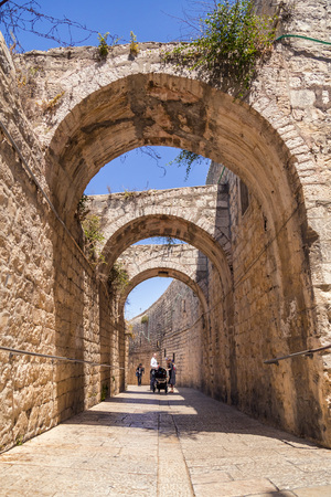 Jerusalem, Israel - June 14, 2018: Ancient streets and buildings in the old city of Jerusalem. Jerusalem is the holy land to the Abrahamic religions; Judaism, Christianity and Islam.