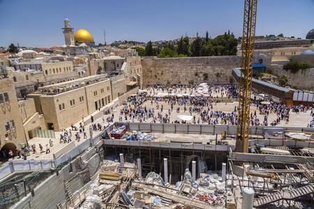 Jerusalem, Israel - June 15, 2018: View from the Temple Mount with the dome of Al Aqsa Mosque and people visiting the Western Wall downstairs, the holy site of the Old City in Jerusalem, Israel. Editorial