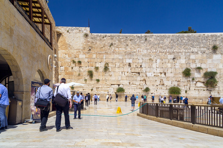 Jerusalem, Israel - June 14, 2018: Jewish people praying against the Western Wall, the second holiest place to the Jews. The Wall is the last remnant of the second Jewish Temple.