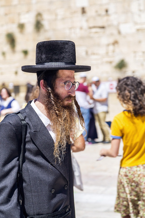 Jerusalem, Israel - June 14, 2018: Jewish man walking in the ancient streets of the old city of Jerusalem. Jerusalem is the holy land to the Abrahamic religions; Judaism, Christianity and Islam.