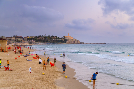 Yafo, Israel - June 10, 2018: Coastal view of the ancient city of Yafo or Jaffanear Tel Aviv, Israel. Cityscape in sunset hour with clouds in the sky.