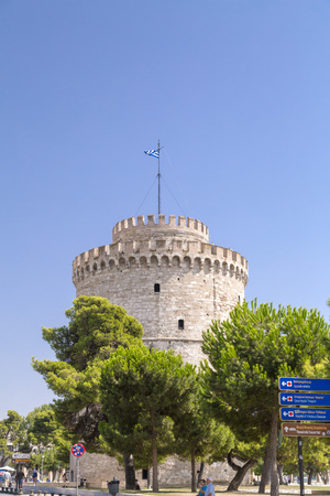 Thessaloniki, Greece - July 22, 2018: The White Tower of Thessaloniki on north shore of the Aegean Sea, Greece. The tower was built as a fortification by Ottoman Sultan Murad II.
