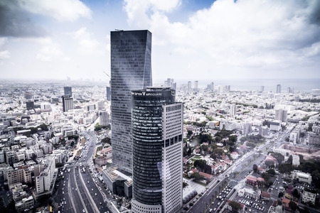 Tel Aviv, Israel - June 9, 2018: Exterior view of the Azrieli Sarona Tower, in Sarona district next to the openair market, Tel Aviv, Israel Sajtókép