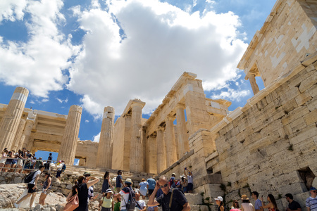 Athens, Greece - July 20, 2018: The reconstructed ancient ruins of Parthenon and Erechtheion at the Acropolis in Athens, the Greek capital. Acropolis is a significant historic landmark. Editorial