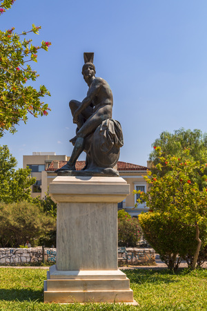 Athens, Greece - July 21, 2018: Statue of Theseus, a mythical founder hero of Athens. The statue is located at a park in plaka district of Athens, Greece