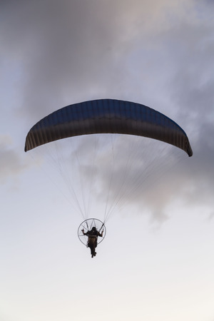 Paramotor, motor-powered paragliding parachute in the sky Stock Photo