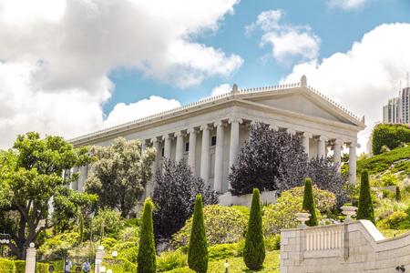 Haifa, Israel - June 18, 2018: Haifa cityscape and Bahai Gardens (Shrine of the Bab), a holy pilgrimage for the Bahai believers built on Mount Carmel in Haifa, Israel.