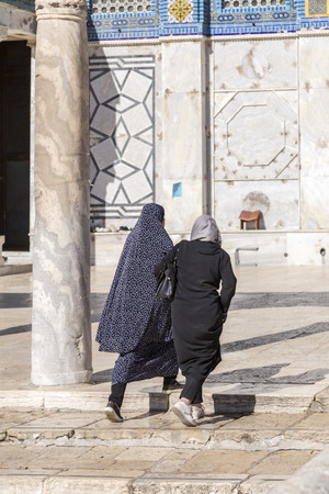 Jerusalem, Israel - June 14, 2018: Two muslim women entering the Dome of the Rock (Al Qubbat As-Sakhrah in Arabic) in the holy site of the Old City in Jerusalem, Israel.