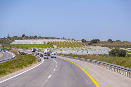 Jerusalem to Haifa, Israel - June 17, 2018: Highway with signs and vehicles in traffic from Jerusalem to Haifa on a sunny summer day.