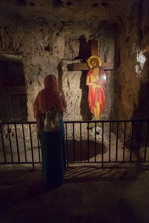Jerusalem, Israel - June 15, 2018: Jesus and cross in Prison of Christ. Monastery of the Praetorium. The Greek Orthodox belive as the real place where Jesus was held the night before his trail.