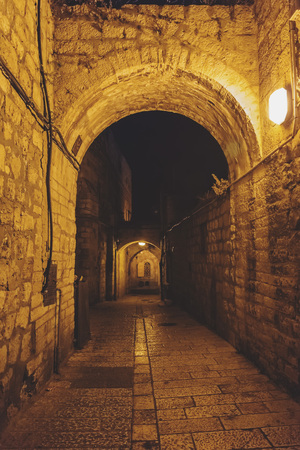 Ancient streets and buildings in the old city of Jerusalem at night