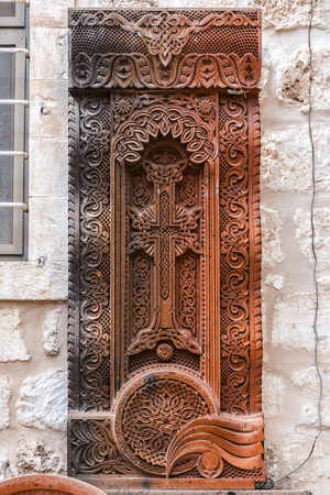 Jerusalem, Israel - June 16, 2018: Traditional Armenian Khachkar, cross-stone art, sacred cross, carved rock found in Jerusalem, Israel.