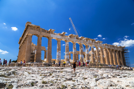 Athens, Greece - July 20, 2018: The reconstructed ancient ruins of Parthenon and Erechtheion at the Acropolis in Athens, the Greek capital. Acropolis is a significant historic landmark.