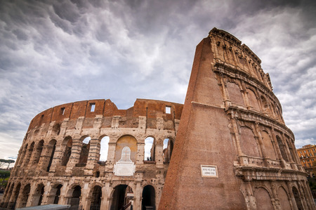 Exterior view of the ancient Roman Colloseum or Flavian Amphitheather in Rome, Italy. Фото со стока