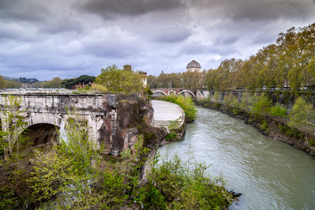Ancient buildings and bridges around Tiber River in Rome, Italy.