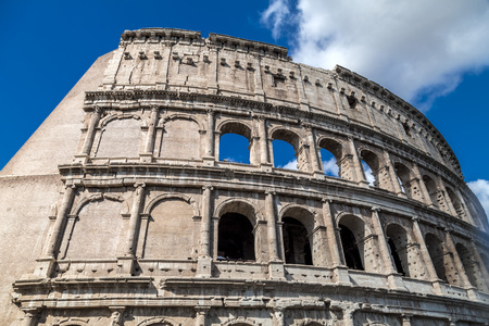 Exterior view of the ancient Roman Colosseum or Flavian Amphitheather in Rome, Italy.