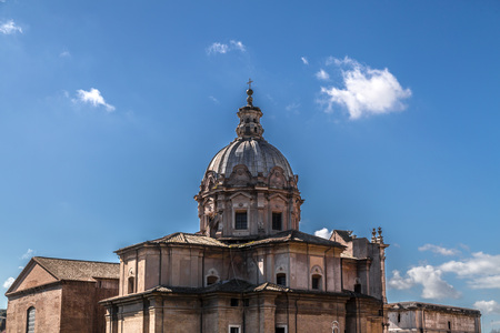 The historical open-air museum Roman Forum, view from Capitolium Hill in Rome, Italy. Santi Martina e Luca Church