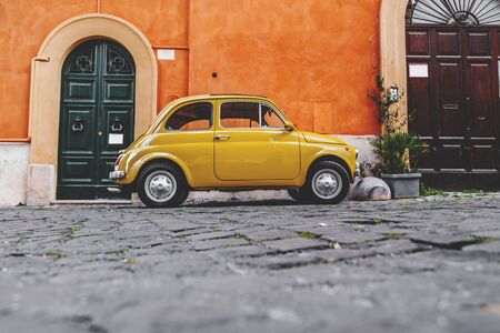 Cityscape and generic architecture from Rome, the Italian capital. Buggy car parked in the street.