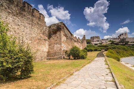 The ancient walls of the castle and Trigonion Tower in the old city Ano Poli in Thessaloniki, Greece. Banco de Imagens