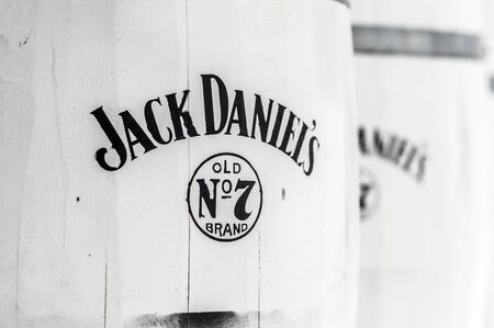Cesme, Turkey - July 15, 2012: Logo of the famous whiskey brand Jack Daniel's on white barrels used as decorative objects at a bar in Cesme, Turkey. 新闻类图片