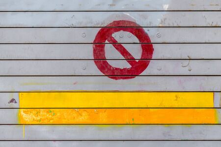 Weathered wooden wall texture, grunge texture background with forbidden sign and yellow copy space