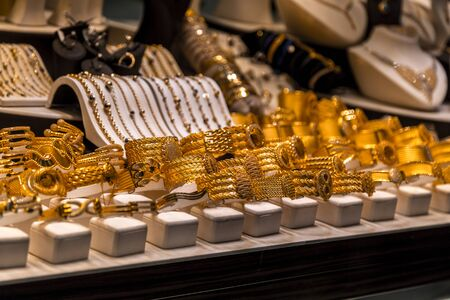 Variety of golden accessories showcased in a shop window at the famous Covered Bazaar (Kapalicarsi) of Bursa, Turkey