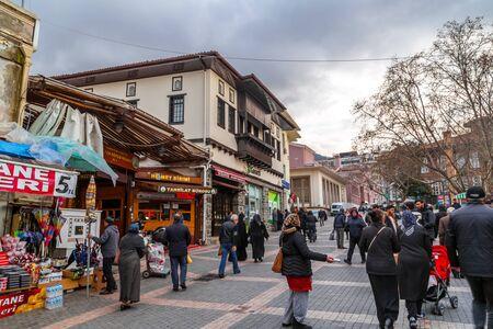 Bursa, Turkey - December 27, 2019: Unidentified Turkish lady selling band aids in the street around the Covere Bazaar of Bursa, Turley