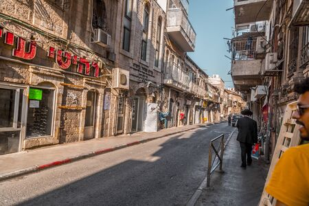Jerusalem, Israel - June 12, 2019: Buildings and stores in the streets of Mea Shearim, the Ultra-Orthodox neighborhood of Jerusalem. Editorial
