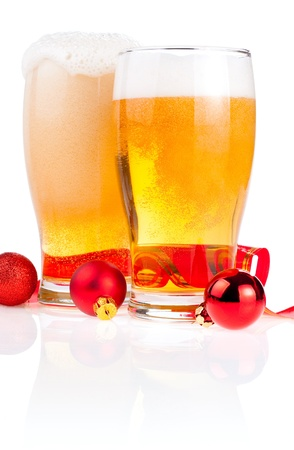 pilsner beer glass: Two glasses fresh lager beer, Red ribbon and Christmas Balls isolated on white background
