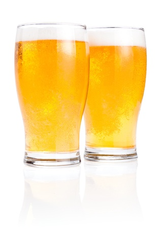 Two glasses fresh lager beer with foam Isolated on white background photo
