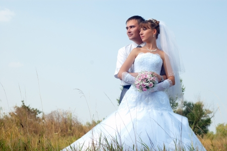 Happy bride and groom outdoors photo