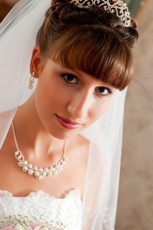 Beautiful bride posing in her wedding day photo