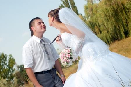 Happy bride and groom in wedding day outdoors photo