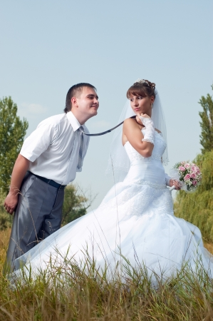 Happy bride and groom in wedding day outdoors Stock Photo - 13755099