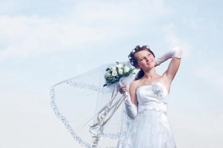 wedding veil: Wonderful and romantic bride on a background blue sky Stock Photo