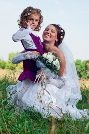 Wonderful young fiancee and beautiful little girl photo