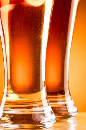 pilsner beer: Bottom of two glass beer over yellow background