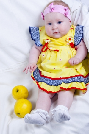 Beautiful little girl and apples photo
