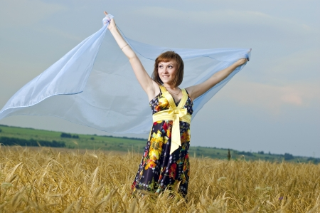 Beautiful young girl is in the field of wheat Stock Photo - 13840217