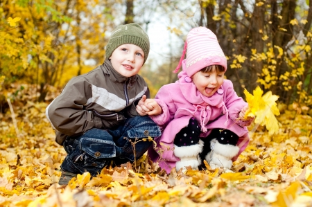Little boy and girl play in a park in autumn Stock Photo - 13849939