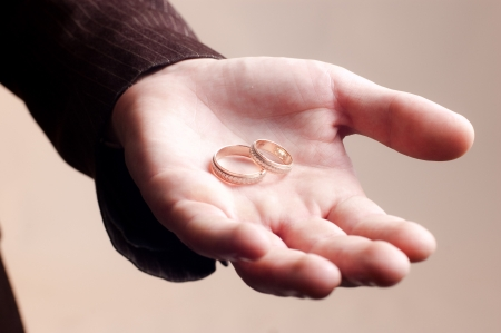 Old golden wedding rings on a man photo