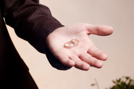 Old golden wedding rings on a man Stock Photo - 13855542