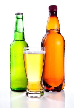 green glass bottle: Isolated Glass Beer in plastic bottle and glass green bottles with beer on a white background Stock Photo