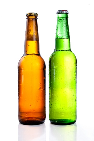 single beer bottle: Green and brown beer bottle with drops drink without label on a white background