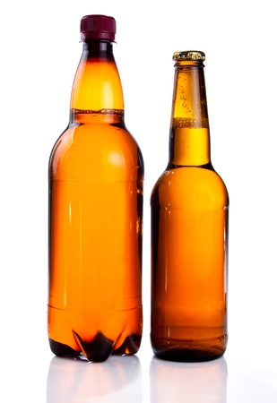 Isolated Brown plastic bottle and glass bottle of beer on a white background photo