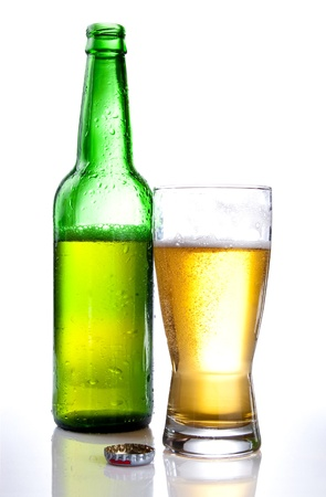 Green bottle and Half drank beer mug isolated on white background photo