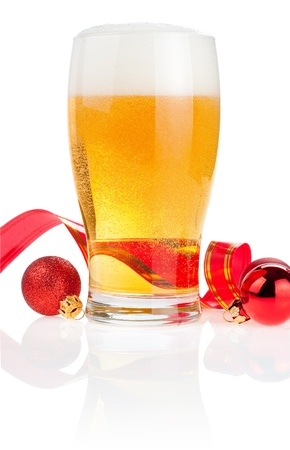Glass fresh beer,  Red ribbon and Christmas Balls isolated on white background photo