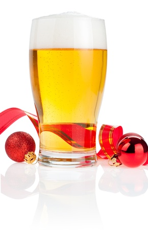 pilsner glass: Glass fresh beer,  Red ribbon and Christmas Balls isolated on white background Stock Photo